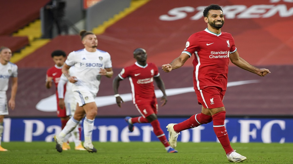 Liverpool's Mohamed Salah, right, celebrates after he scored his side's fourth goal during the English Premier League football match against Leeds United, at the Anfield stadium, in Liverpool, Saturday, Sept. 12, 2020. (Shaun Botterill, Pool via AP).
