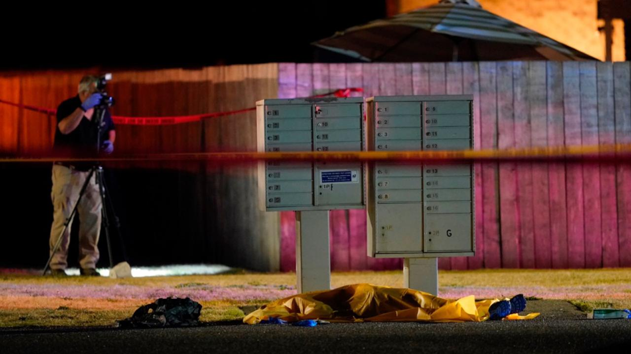 Officials work at a scene late Thursday, Sept. 3, 2020, where a man suspected of fatally shooting a supporter of a right-wing group in Portland, Ore., the week before was killed as investigators moved in to arrest him in Lacey, Wash.  (AP Photo/Ted Warren)