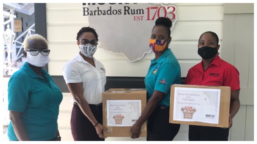 Mount Gay Distilleries' Agricultural Manager Jacklyn Broomes (second from left) handing over one of the packages to St Lucy Parish Independence Committee Chairperson Olivia Sobers while St Lucy Parish Independence Committee Project Coordinator Janice Springer (left) and Mount Gay Distilleries' Human Resources Manager, Candace Browne (right) look on.