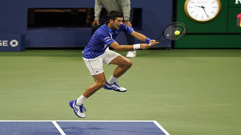 Novak Djokovic, of Serbia, returns to Damir Dzumhur, of Bosnia and Herzegovina, during the first round of the US Open tennis championships, Monday, Aug. 31, 2020, in New York. (AP Photo/Frank Franklin II).