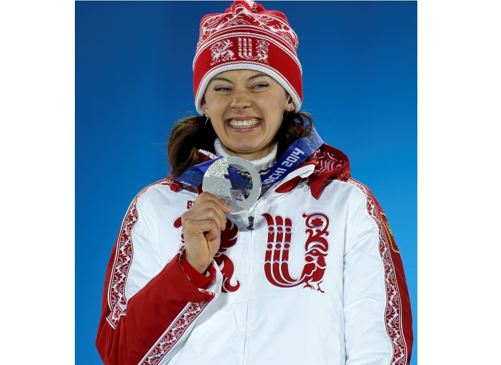 In this Monday, Feb. 10, 2014 file photo, women's 7.5K sprint silver medalist Olga Vilukhina of Russia smiles with her medal during the medals ceremony at the 2014 Winter Olympics, in Sochi, Russia. Two-time Olympic biathlon champion Olga Zaitseva lost her appeal Thursday Sept. 24, 2020, against disqualification from the 2014 Sochi Olympics for her part in Russia's state-backed doping program. (AP Photo/Morry Gash, File).