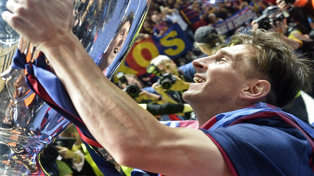 In this June 6, 2015 file photo, Barcelona's Lionel Messi smiles with the trophy after winning the Champions League final match against Juventus Turin at the Olympic stadium in Berlin, Germany. (AP Photo/Martin Meissner).