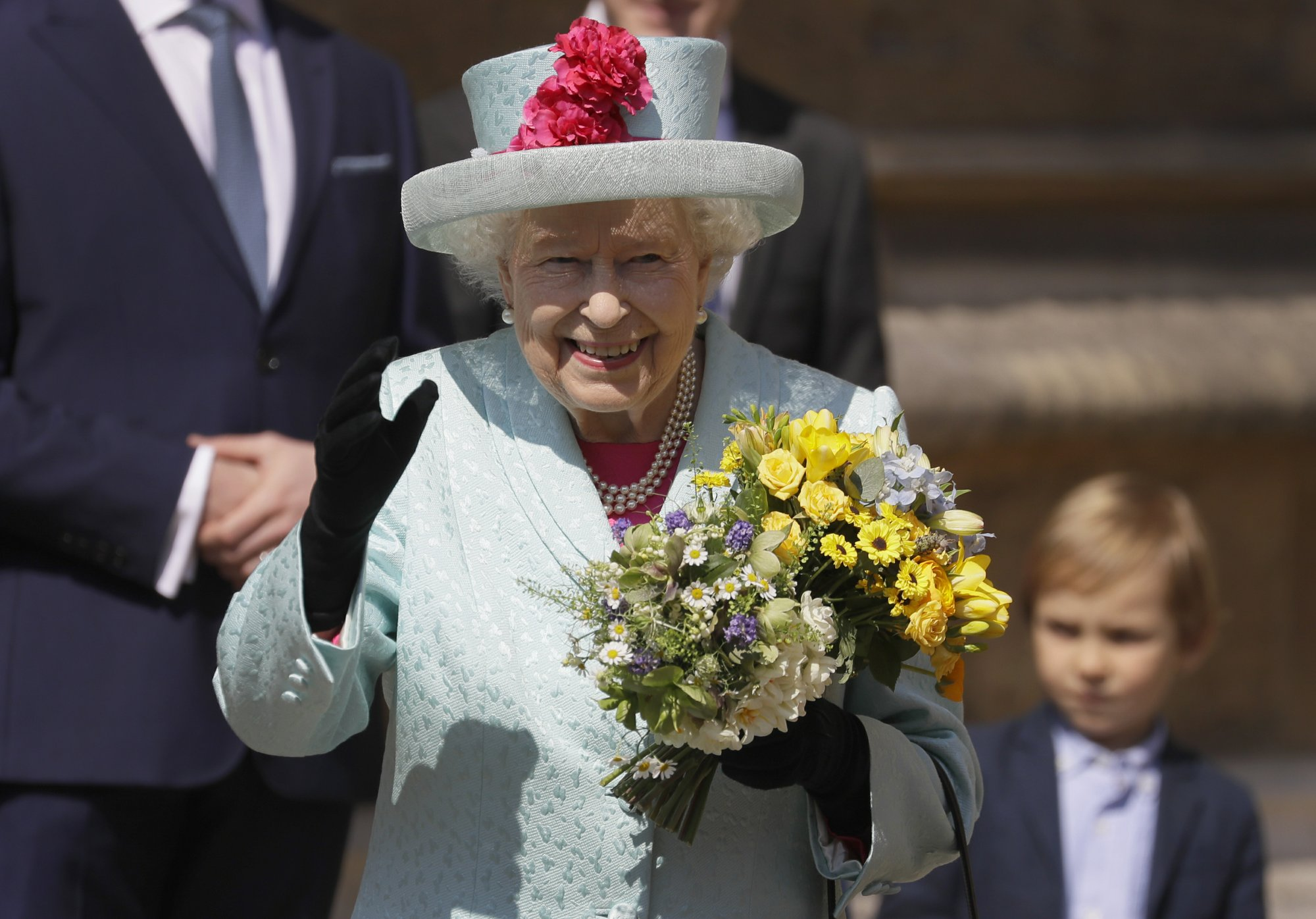 Britain's Queen Elizabeth II waves to the public as she leaves after attending the Easter Mattins Service at St. George's Chapel at Windsor Castle in England on Sunday, April 21, 2019. (AP Photo/Kirsty Wigglesworth, pool)