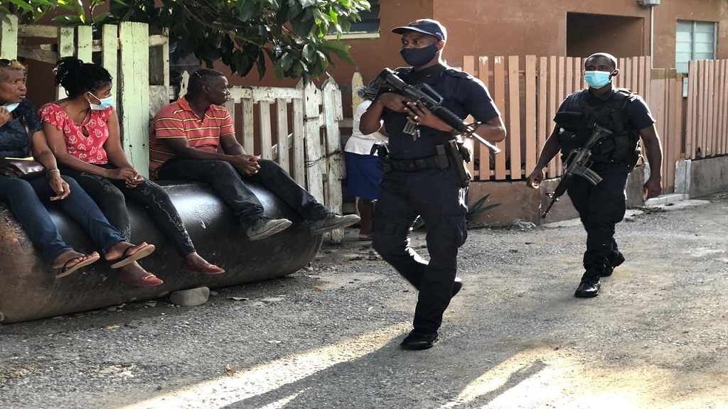 Heavy police presence in Mona Commons, St Andrew after the murder of two women in the community on Thursday afternoon.