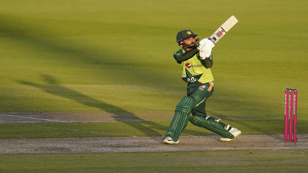 Pakistan's Mohammad Hafeez watches the ball after playing a shot during the third Twenty20 cricket match against England, at Old Trafford in Manchester, England, Tuesday, Sept. 1, 2020. (AP Photo/Jon Super, Pool).