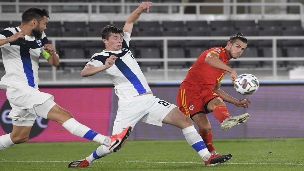 Gareth Bale, right, playing for Wales in the UEFA Nations League football match against Finland, in Helsinki, Finland, Thursday, Sept. 3, 2020. (Markku Ulander/Lehtikuva via AP).