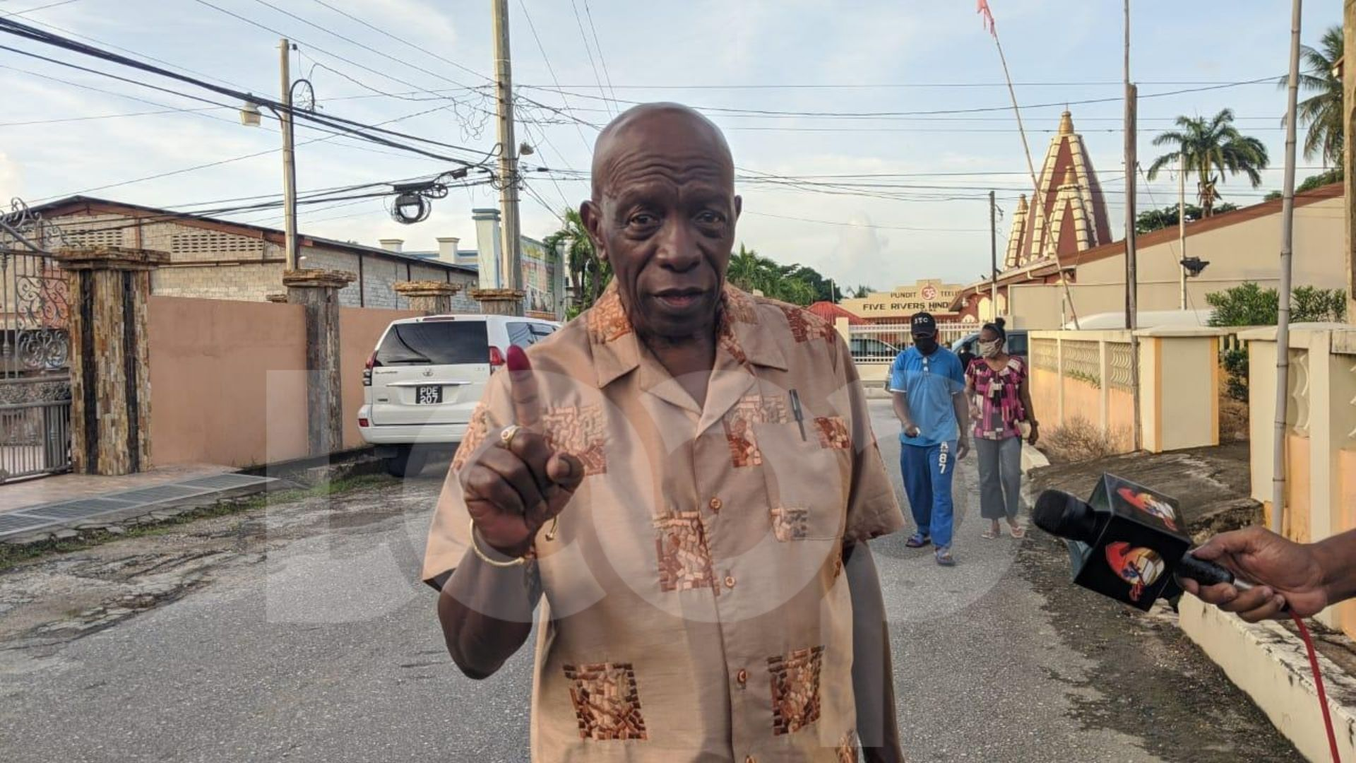 Jack Warner, ILP candidate for Lopinot/Bon Air West shows his stained finger after casting his vote in the 2020 General Election.