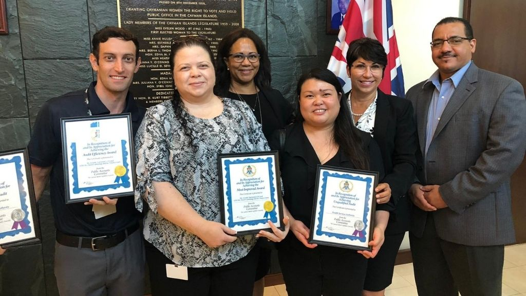 (L-R) MLA Chris Saunders with HSA's Chief Financial Officer Dawn Cummings, Chief Executive Officer Lizzette Yearwood and Deputy Board Chairman Rolston Anglin accepting the awards.