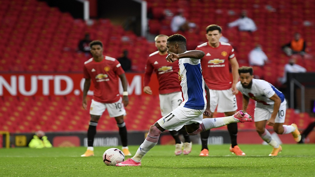 Crystal Palace's Wilfried Zaha scores his side's second goal during the English Premier League football match against Manchester United at the Old Trafford stadium in Manchester, England, Saturday, Sept. 19, 2020. (Shaun Botterill/Pool via AP).