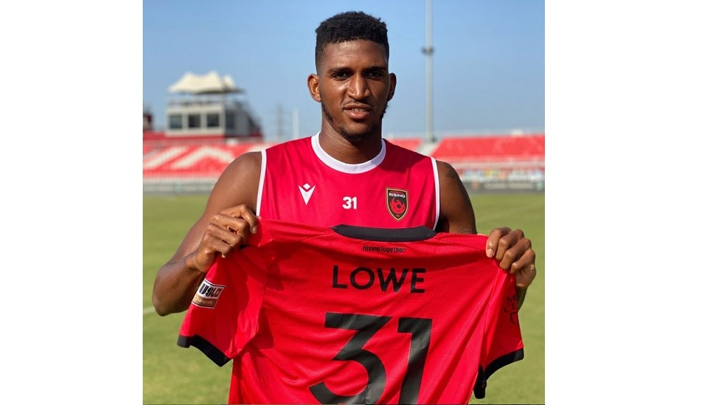 Damion Lowe shows off his jersey after signing with American  professional football team Phoenix Rising FC.