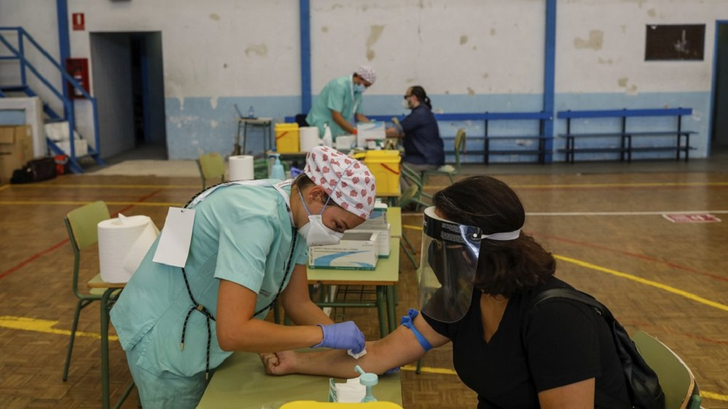 Teachers and auxiliary staff take COVID-19 tests in Madrid, Spain, Thursday, Sept. 3, 2020. The Madrid region is a coronavirus hot spot, with almost 32,000 new cases officially recorded over the past two weeks. The tests are mandatory for school employees. (AP Photo/Bernat Armangue)