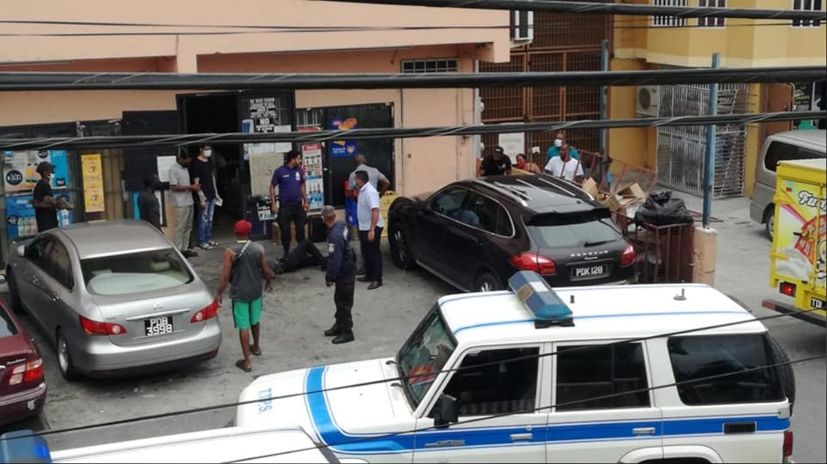 The scene of a shooting in Sangre Grande which left a police officer injured and a retired officer in police custody.