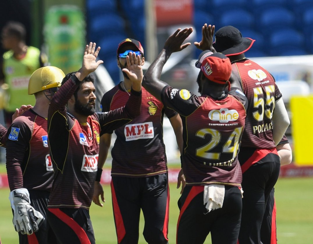 The Trinbago Knight Riders celebrate the fall of a wicket during their victory over the St Kitts and Nevis Patriots in Match 29 of the Hero Caribbean Premier League on 6th September 2020 at the Brian Lara Cricket Academy, Tarouba. (Photo by Randy Brooks - CPLT20/Getty Images)