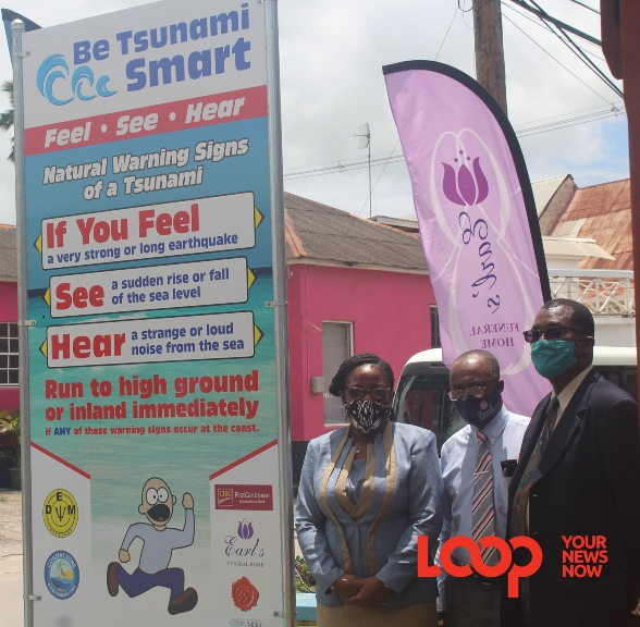 Director of DEM Kerry Hinds (L) alongside sponsor and Director of CZMU and TSCCH Co-Chair (R) Dr Leo Brewster at the unveiling of the sign in Speightstown St Peter