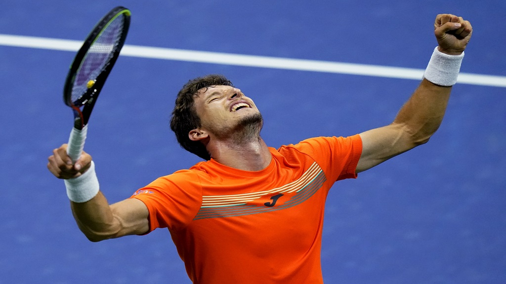 Pablo Carreno Busta, of Spain, reacts after defeating Denis Shapovalov, of Canada, during the quarterfinal round of the US Open tennis championships, early Wednesday, Sept. 9, 2020, in New York. (AP Photo/Frank Franklin II).