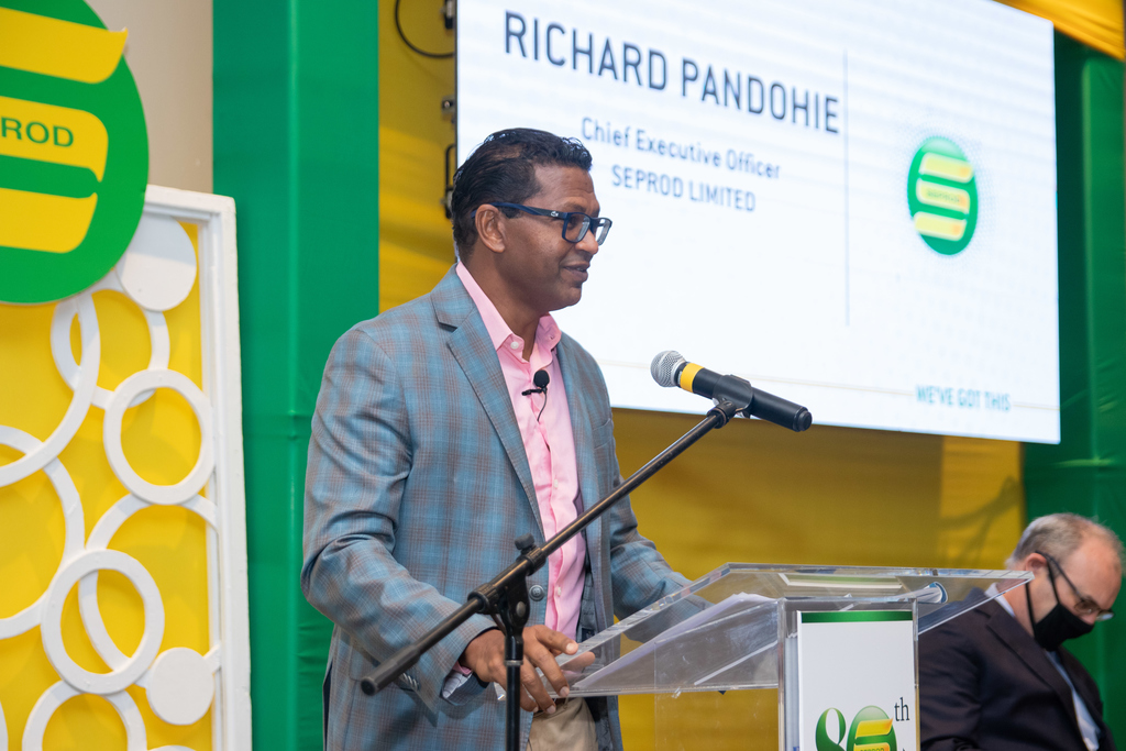 Seprod CEO Richard Pandohie addresses the company's annual general meeting on September 21, 2020. Partially hidden and seated to Pandohie's right is Seprod chairman, P.B Scott. (Photo contributed)