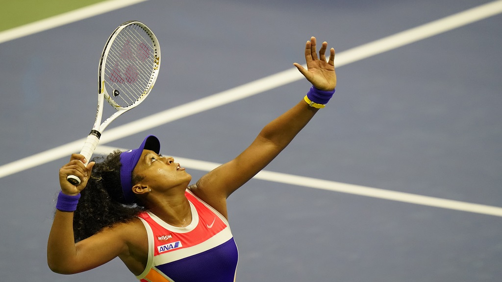 Naomi Osaka, of Japan, serves to Camila Giorgi, of Italy, during the second round of the US Open tennis championships, Wednesday, Sept. 2, 2020, in New York. (AP Photo/Frank Franklin II).