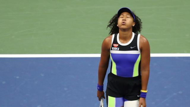 La Japonaise Naomi Osaka soupire après son point gagnant qui lui donne le titre de l'US Open après la finale disputée contre la Bélarusse Victoria Azarenka, le 12 septembre 2020 à Flushing Meadows, New York [MATTHEW STOCKMAN / GETTY IMAGES NORTH AMERICA/AFP]