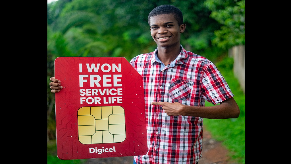 Digicel's Free Service For Life winner, Andre Shaw, shares a sunny smile from the tropical hills of St Andrew.