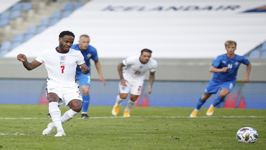 England's Raheem Sterling scores from the penalty spot during the UEFA Nations League football match against Iceland in Reykjavik, Iceland, Saturday, Sept. 5, 2020. (AP Photo/Brynjar Gunnarson).