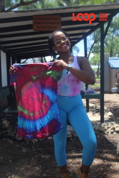 Owner of Artist Made Barbados Shanika Grimes showing off one of her tie-dye creations