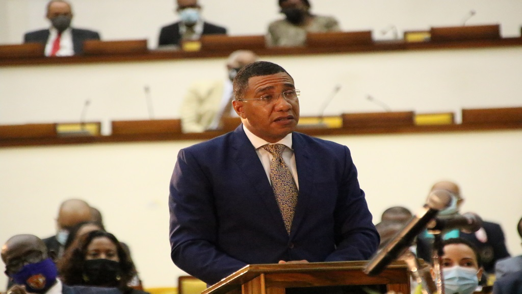 Prime Minister Andrew Holness addresses the swearing-in ceremony for Members of Parliament on Tuesday.