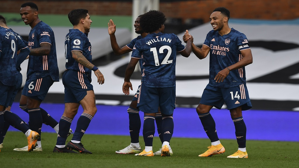 Arsenal's Pierre-Emerick Aubameyang, right, is cheered by William (2nd right) and other teammates after scoring during the English Premier League football match against Arsenal in London, Saturday, Sept. 12, 2020. (Ben Stansall/Pool via AP).