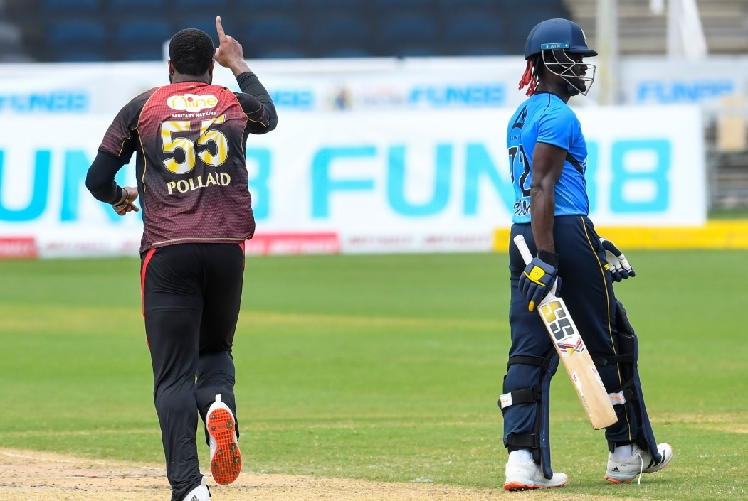 Kieron Pollard (left) of Trinbago Knight Riders celebrates the dismissal of Andre Fletcher of St Lucia Zouks during match 27 of the Hero Caribbean Premier League at the Brian Lara Cricket Academy  in Tarouba, Trinidad and Tobago on September 5, 2020. (Photo by Randy Brooks - CPL T20/CPL T20 via Getty Images).