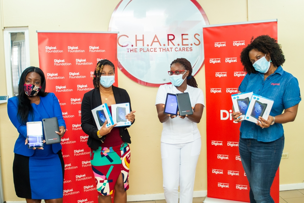 CHARES Associate Clinical Psychologist, Justine East-Campbell, and Racquel Brown, CHARES Programme Director, stand grateful for the donation of tablets and internet service received from Digicel and the Digicel Foundation. The devices will assist children of parents living with HIV/AIDS to continue their online learning in response to school closures during the COVID-19 pandemic.