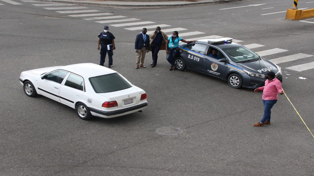 Police officers at the scene of the incident on Hagley Park Road in St Andrew on Tuesday.