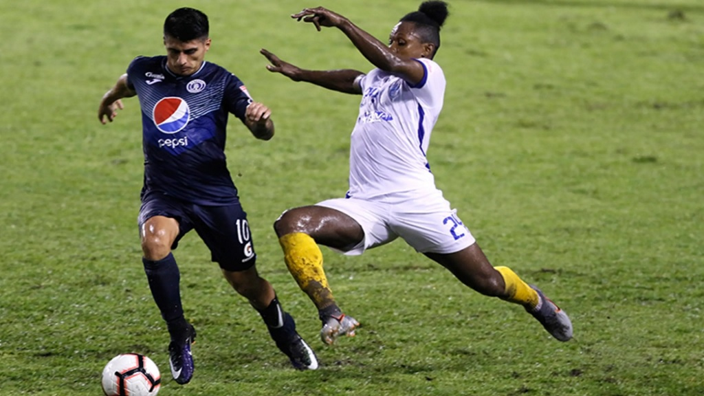 Matias Galvaliz of FC Motagua (at left) and Mark Miller of Waterhouse FC of Jamaica battle for the possession of the ball in the quarterfinal second leg of the  Scotiabank Concacaf League on October 2, 2019, at the Estadio Olimpico Metropolitano in San Pedro Sula, Honduras.