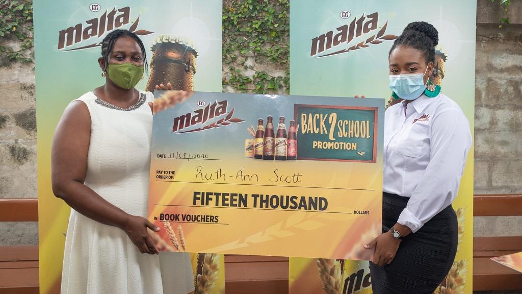 Ruth-Ann Scott (left) receives her $15,000 book voucher from Melissa-Kim Dunkley, Brand Manager for Malta