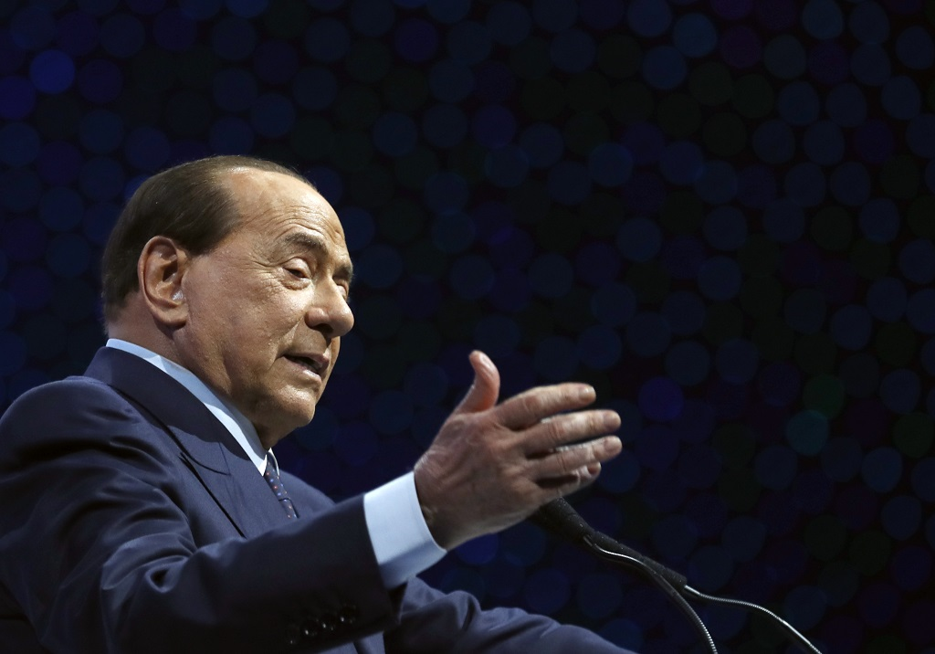 FILE - In this Nov. 21, 2019 file photo, Silvio Berlusconi, Italian former Premier and President of Forza Italia (Go Italy) party speaks during the European Peoples Party (EPP) congress in Zagreb, Croatia. Italy's former prime minister and right-wing leader Silvio Berlusconi has tested positive to coronavirus after a precautionary check, his press office said on Wednesday, Sept. 2, 2020.  (AP Photo/Darko Vojinovic)