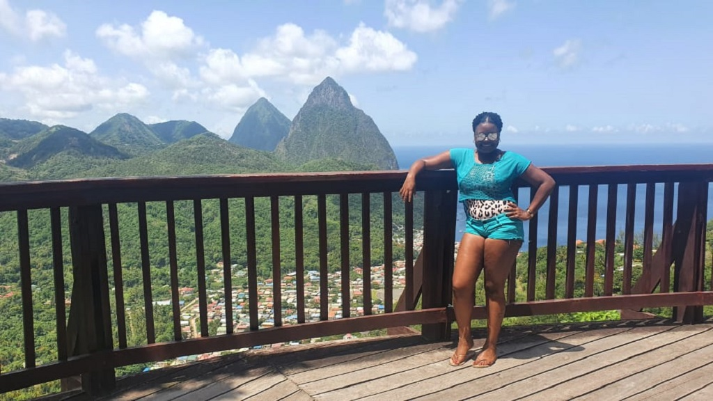Sharine Joseph poses with the Pitons in the background
