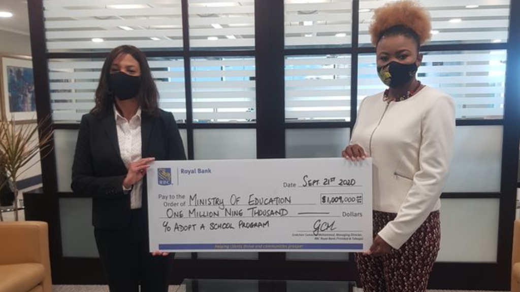 Photo: RBC Royal Bank, Managing Director (T&T), Gretchen Camacho-Mohammed (left) presents Education Minister Nyan Gadsby-Dolly (right) with a cheque for $1,009,000 which will be used to purchase 300 devices. Credit: Ministry of Education.