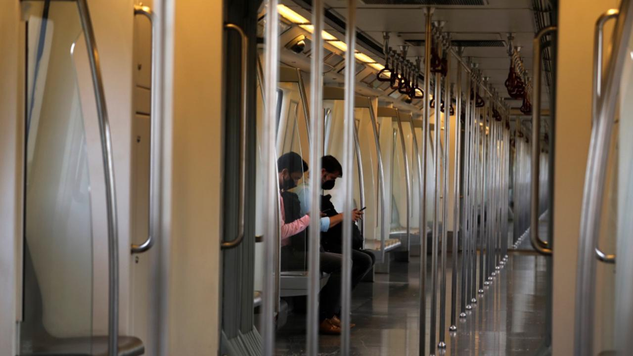 Commuters travel in an almost empty Delhi metro train in New Delhi, India, Monday, Sept. 7, 2020. India's coronavirus cases are now the second-highest in the world and only behind the United States, as the caseload crosses Brazil on a day when urban metro trains partially resume service in the capital New Delhi and other states. (AP Photo/Manish Swarup)