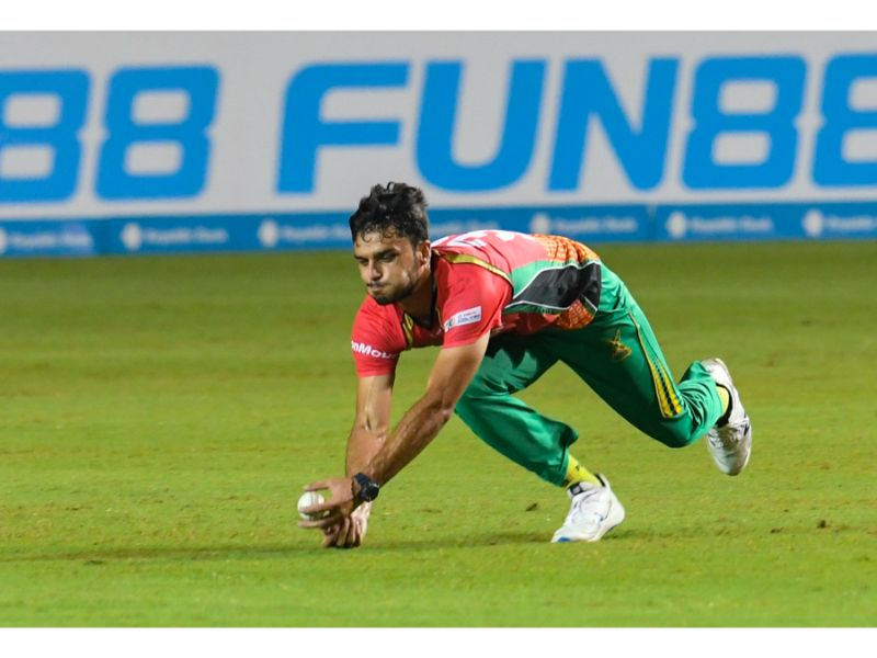 Guyana Amazon Warriors bowler Naveen-ul-Haq takes a diving catch during their victory over the St Lucia Zouks on Wednesday night at the Brian Lara Cricket Academy, Tarouba, in Match 24 of the Hero Caribbean Premier League. (Photo by Randy Brooks - CPLT20/Getty Images).