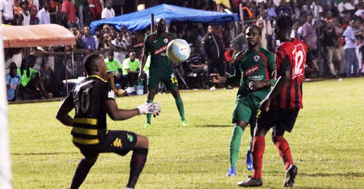 Action from a Red Stripe Premier League game between Humble Lion and Arnett Gardens.