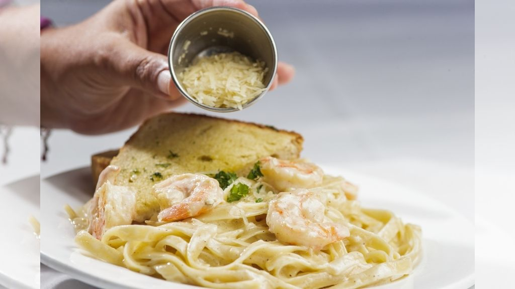 Dj Kurt Riley savoured a couple of meals including Chez Maria's popular shrimp Alfredo, topped with Parmesan cheese. (Photo: Contributed)