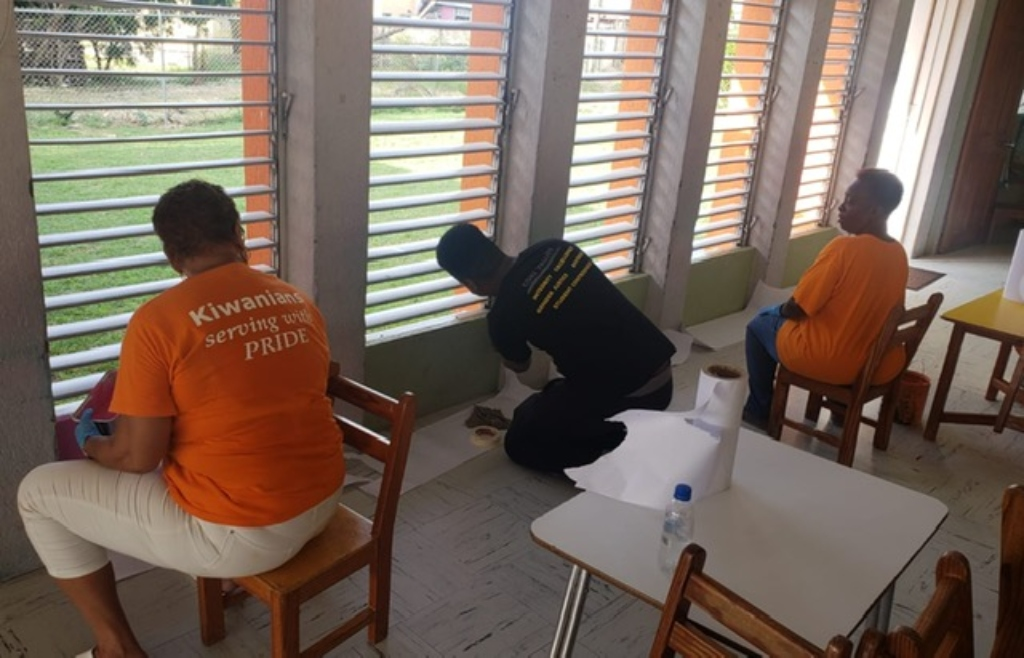 Kiwanis members painting an area of the Eden Lodge Day Nursery