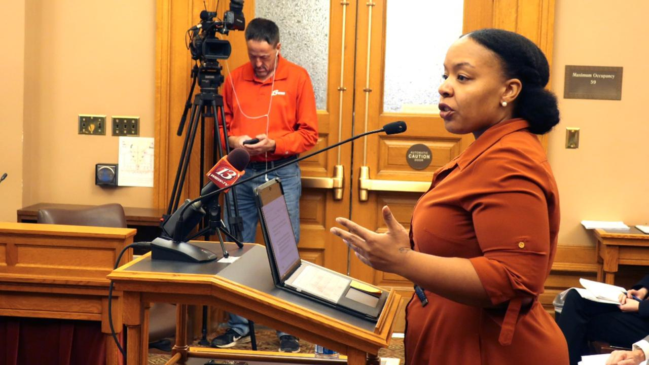 In this Jan. 28, 2020, file photo, Michele Watley, founder of Shirley's Kitchen Cabinet, testifies in favor of a bill before the Kansas Legislature to ban discrimination based on hairstyles in employment, housing and public accommodations during a committee hearing at the Statehouse in Topeka, Kansas. (AP Photo/John Hanna, File)