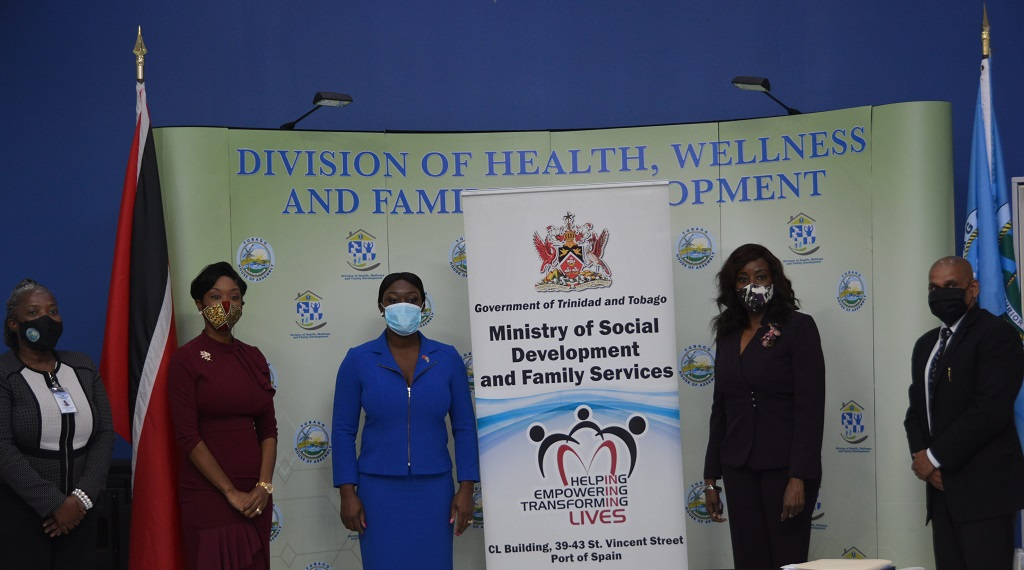 Minister of Social Development and Family Services Donna Cox takes a photo following the meeting with the Tobago Division of Health, Wellness and Family Development's Administrator Cherryl-Ann Solomon, Asst. Secretary Nadine Stewart-Phillip, Secretary Tracy Davidson-Celestine and the Ministry's Deputy Permanent Secretary Vijay Gangapersad.