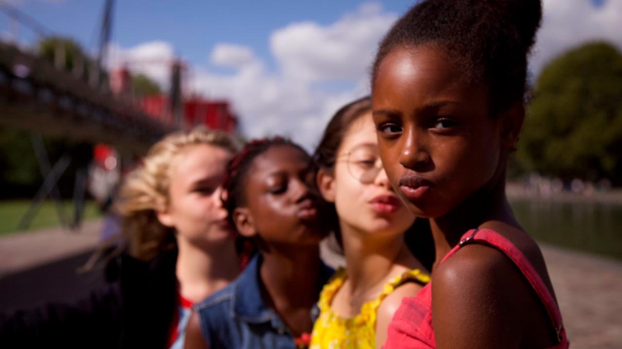"This image released by Netflix shows the cast of the coming-of-age film ""Cuties."" The backlash to the French independent film ""Mignonnes,"" or ""Cuties,"" started before it had even been released because of a poster that went viral for its provocative depiction of its young female actors. (Netflix via AP, File)"