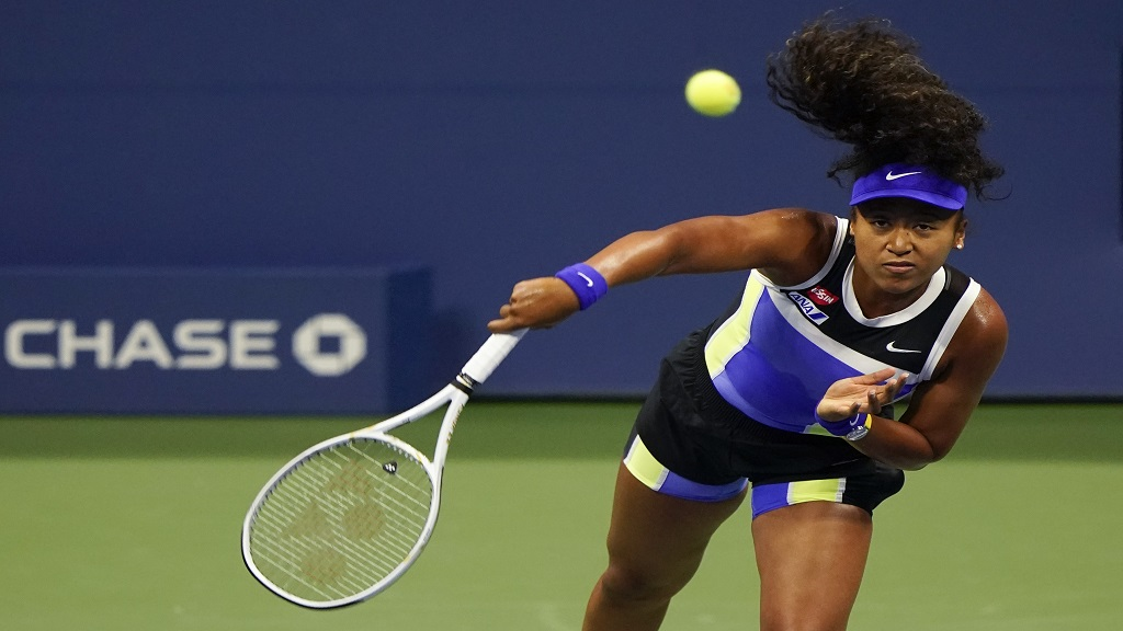 Naomi Osaka, of Japan, serves to Misaki Doi, of Japan, during the first round of the US Open tennis championships, Monday, Aug. 31, 2020, in New York. (AP Photo/Frank Franklin II).