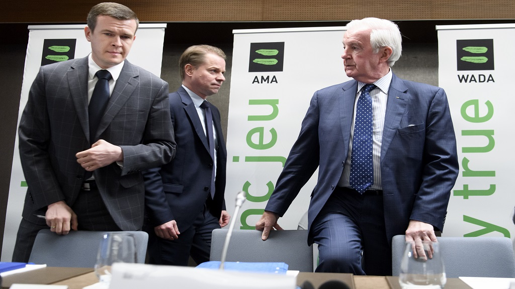 In this Dec. 9, 2019, file photo, Witold Banka, left, president-elect of World Anti-Doping Agency; Craig Reedle, right, WADA then-president; and Olivier Niggli, centre, director general, arrive for a news conference in Lausanne, Switzerland. The World Anti-Doping Agency will consider rules changes that would allow it to sanction the United States if it stops paying its annual dues to the drug-fighting organisation. (Laurent Gillieron/Keystone via AP, File).