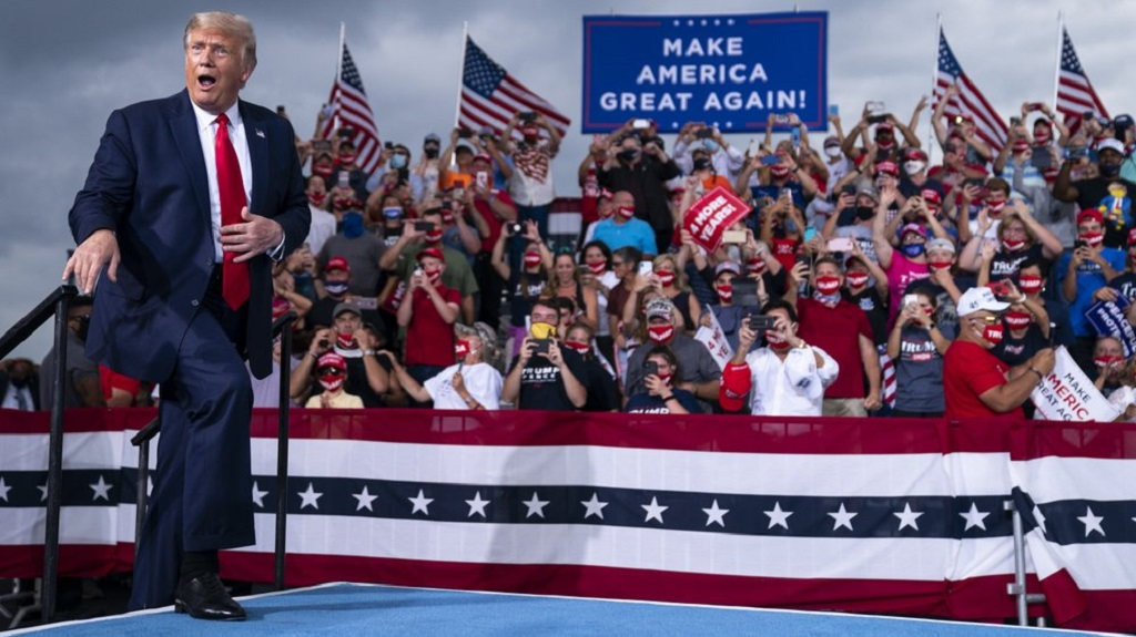 President Donald Trump reacts to the crowd as he arrives to speak at a campaign rally at Smith Reynolds Airport, Tuesday, September 8, 2020, in Winston-Salem, NC. (AP Photo/Evan Vucci)