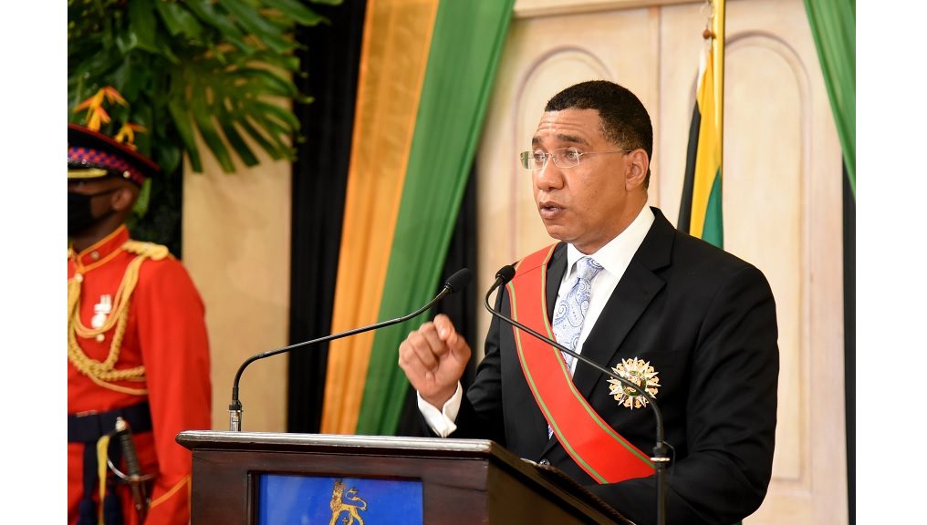 Prime Minister Andrew Holness highlights a matter of importance while addressing attendees at his swearing-in ceremony at King's house on Monday. (Photo: JIS)