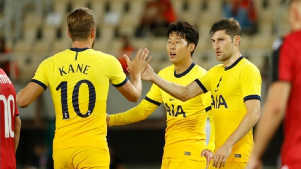Tottenham's Son Heung-min (centre) celebrates his goal with teammates during a Europa League third qualifying round football match against Shkendija at the National Arena Todor Proeski in Skopje, North Macedonia, Thursday, Sept. 24, 2020. (AP Photo/Boris Grdanoski).