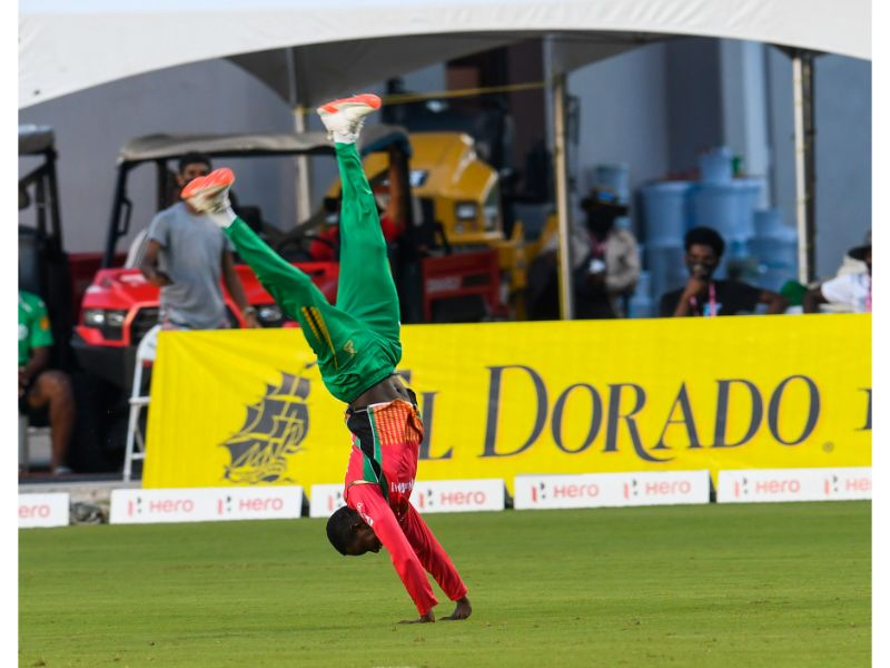 Guyana Amazon Warriors' spinner Kevin Sinclair does a somersault to celebrate a wicket against the Barbados Tridents in Match 22 of the 2020 Hero Caribbean Premier League on 1st September 2020 at the Brian Lara Cricket Academy, Tarouba. (Photo by Randy Brooks - CPLT20/Getty Images)