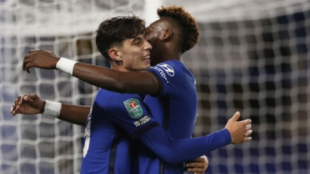 Chelsea's Kai Havertz,left, celebrates with his teammate Tammy Abraham, after scoring his team's second goal during the English League Cup third round football match against Barnsley at Stamford Bridge in London, Wednesday, Sept. 23, 2020.